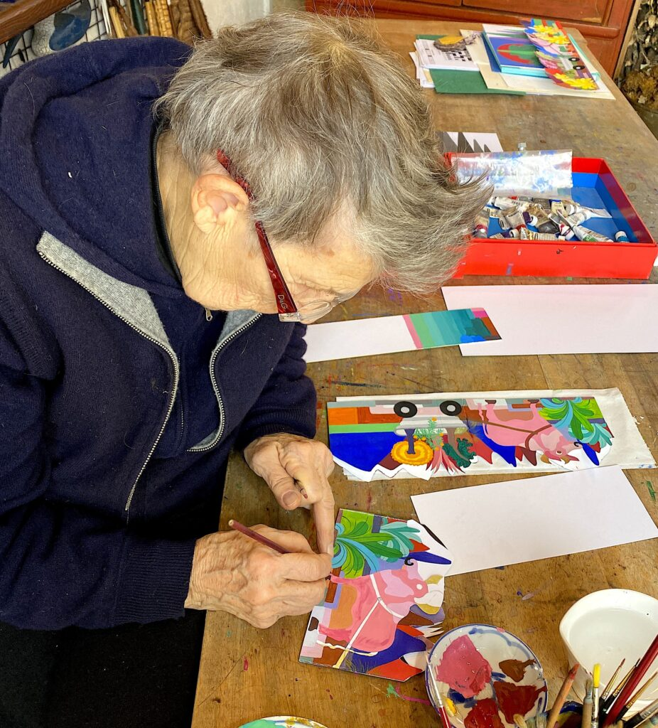 Jean, painting the ox in her art studio.