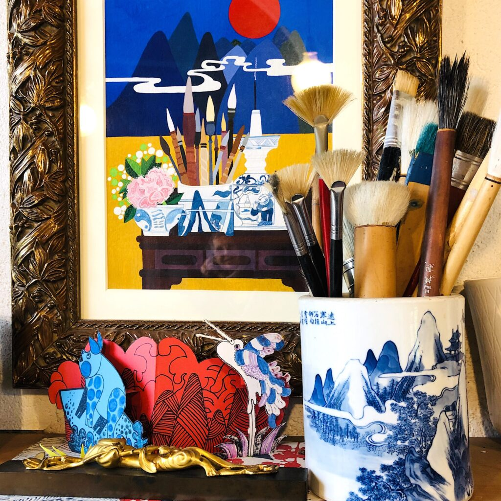 Paintbrushes in Blue and White Vase by Jean Tori in the studio_c