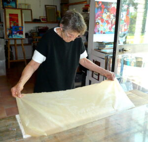 Jean Tori placing paper onto the frame part 1