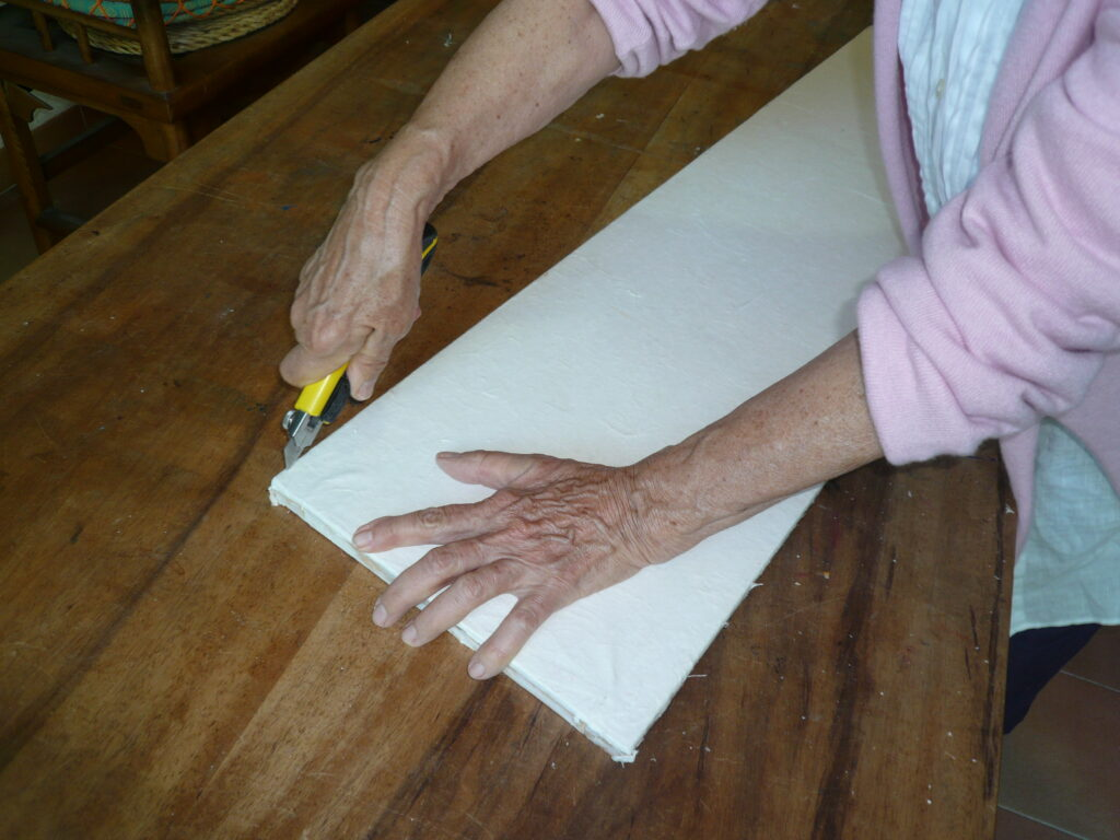 1 Cutting the paper canvas from the frame Jean in studio
