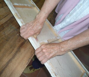 3 Jean using hands to remove paper from frame