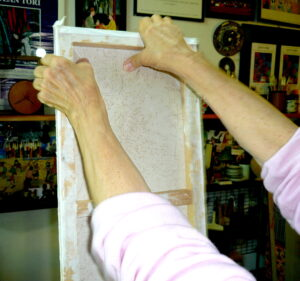 4 Jean removing paper canvas from wooden frame