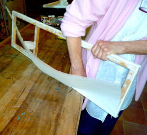 7 Jean removing paper canvas