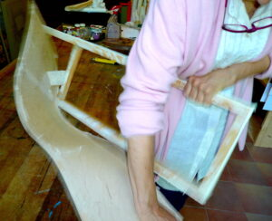 8 Jean pulling off paper from wooden frame