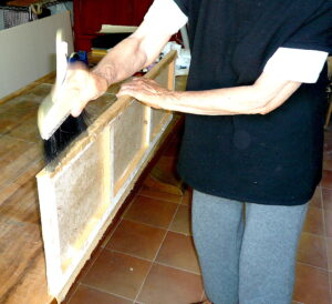Jean Pummelling the Sides of the Wooden Frame