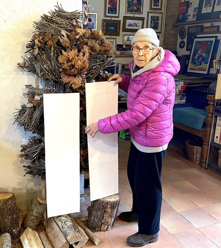 Jean with drying paper canvas in the art studio